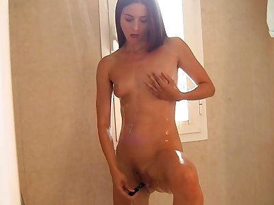 My slutty amateur gf plays with a dildo and my dick